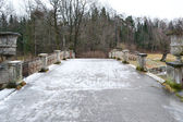 The bridge through the river the Slav in Pavlovsk park — Stock Photo