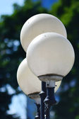 Street round lamp in the park — Stock Photo