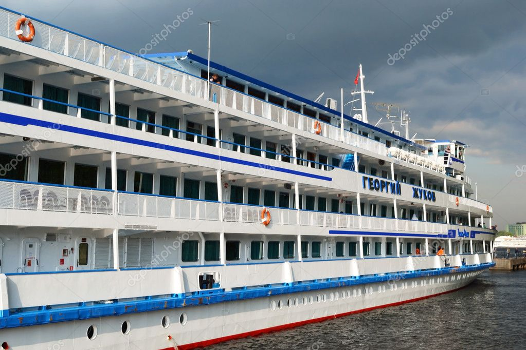 St.Petersburg, Russia - May 28, 2011: River cruise ship to berth quay in St. Petersburg on a cloudy summer day  Stock Photo #8339811