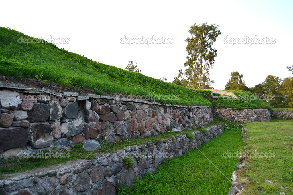 Wall of old Korela fortress in the town of Priozersk at evening, Russia — Stock Photo #8503535
