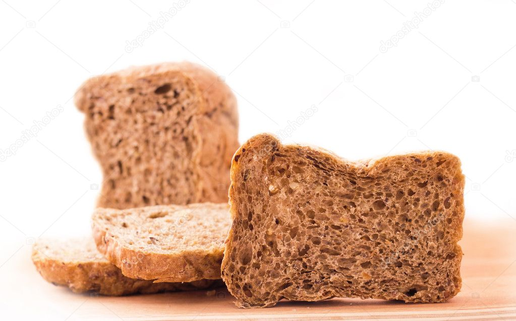 Sliced bread on kitchen board isolated on white background — Stock Photo #9825245