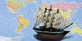 Sailing ship on map of world — Stock Photo