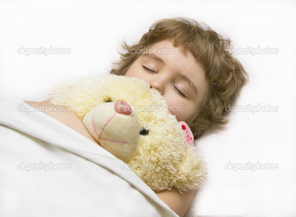 Little boy (European) sleeping in bed with toy bear. — Stock Photo #10665427