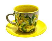 Taza con lirios amarillos — Foto de Stock