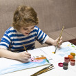Boy painting — Stock Photo #10731105