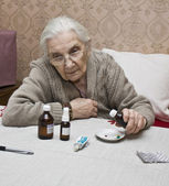 Old lady with medicines — Stock Photo