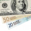 Euro and dollar banknotes isolated on white — Stock Photo