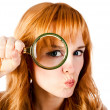 Woman with magnifying glass — Stock Photo #8764597