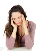 Attractive young woman with migraine — Stock Photo