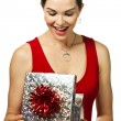 Attractive young woman looking in a gift box - Stock Photo