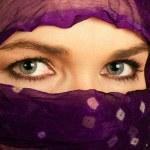 Closeup of a beautiful Indian or asian woman wearing a veil — Stock Photo #10393004