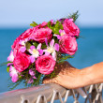 Beautiful wedding bouquet held by bride — Stock Photo