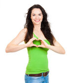 Woman forming love heart with hands — Stock Photo
