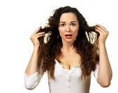 Beautiful young woman having a bad hair day — Stock Photo
