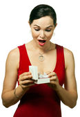 Very attractive woman opening jewellery gift box — Stock Photo