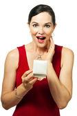 Surprised beautiful woman holding jewellery gift box — Stock Photo