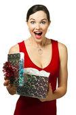 Beautiful young woman opening gift box — Stock Photo