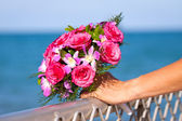 Beautiful wedding bouquet held by bride — Stock Photo