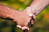 Firm handshake between two men — Stock Photo