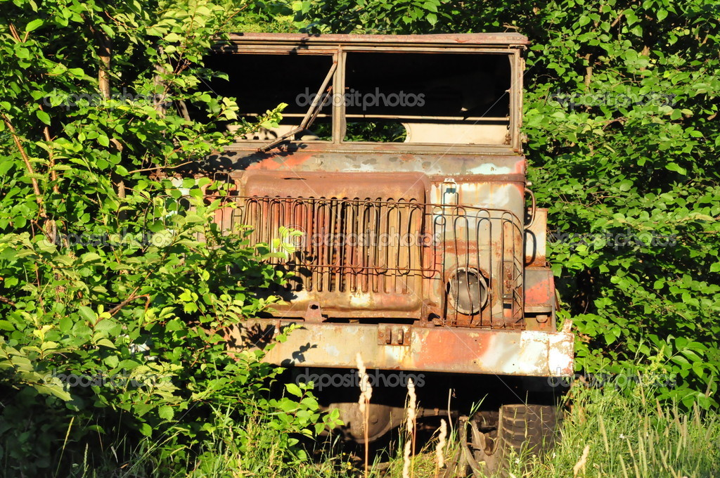 Old forgotten military vehicle in the woods — Stock Photo #8478711