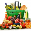 Stockfoto: Shopping basket with grocery products isolated on white