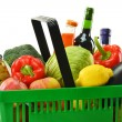 Foto Stock: Shopping basket with grocery products isolated on white