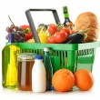 Stok fotoğraf: Shopping basket with grocery products isolated on white