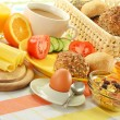 Breakfast including rolls, egg, cheese, coffee and orange juice — Stock Photo #8712091