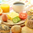 Breakfast including rolls, egg, cheese, coffee and orange juice — Stock Photo #8712255