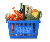 Shopping basket and groceries isolated on white — Stok fotoğraf