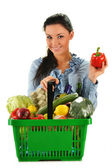 Young woman with shopping basket isolated on white — Stock Photo