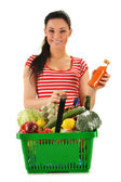Young woman with shopping basket isolated on white — ストック写真