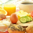 Breakfast including rolls, egg, cheese, coffee and orange juice — Stock Photo