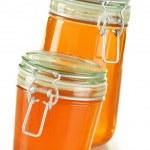 Jars of honey isolated on white — Stock Photo #9005693