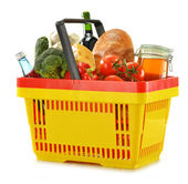 Shopping basket and groceries isolated on white — ストック写真