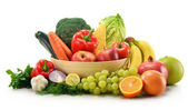 Composition with vegetables and fruits isolated on white — Stock Photo