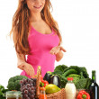 Young woman with basket full of vegetables and fruits - Stock Photo