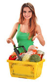 Young caucasian woman with shopping basket isolated on white — Stock Photo
