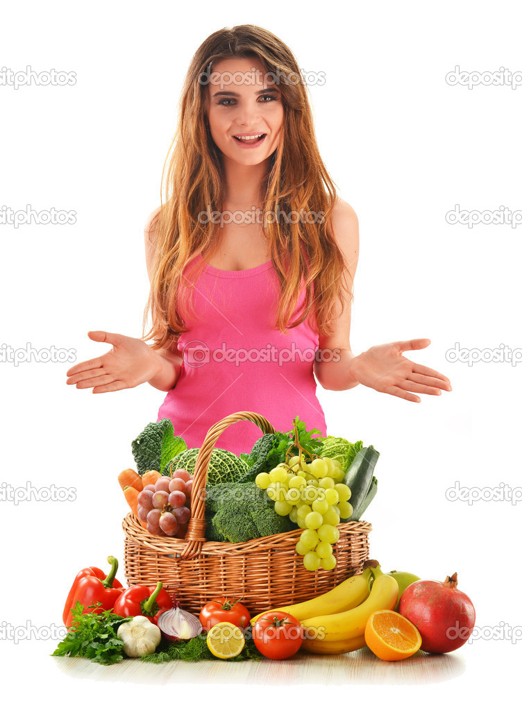 Young attractive woman with variety of fresh vegetables and fruits isolated on white — Stock Photo #9209828