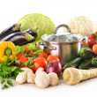 Composition with pot and fresh vegetables isolated on white — Stock Photo