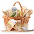 Composition with Euro banknotes in wicker basket — Stock Photo #9832735