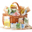 Composition with Euro banknotes in wicker basket — Stock Photo