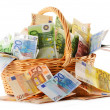 Composition with Euro banknotes in wicker basket — Stock Photo #9962411