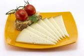 Some slices of manchego cheese from Spain — Stock Photo