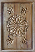Floral tars motifs carved on the old wooden doors. — Stock Photo