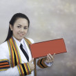 Stock Photo: Asithai attractive Graduate female student - holding red blan