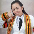 Stock Photo: Asithai attractive Graduate female student - phone calling ha
