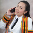 Asithai attractive Graduate female student - mobile phone cal — Stock Photo #8385160