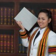 Asian thai attractive Graduate female student in library — Stock Photo