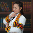 Stock Photo: Asithai attractive Graduate female student in library